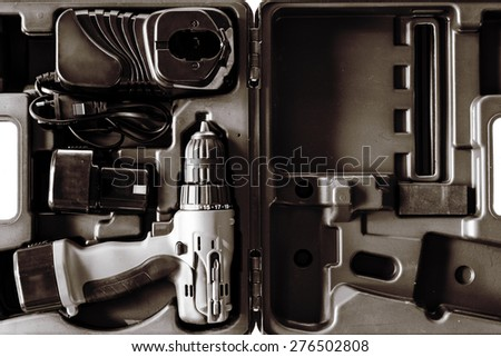 Electric drill in a box / Black and White - stock photo