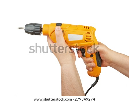 Electric drill in his hands isolated on white background - stock photo