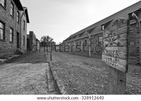 Electric fence and buildings in former Nazi concentration camp Auschwitz I, Poland