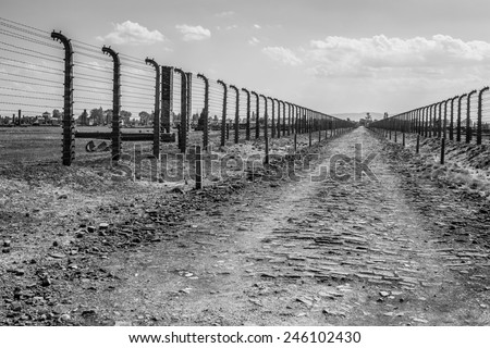 Electric fence in former Nazi concentration camp Auschwitz, Poland - stock photo