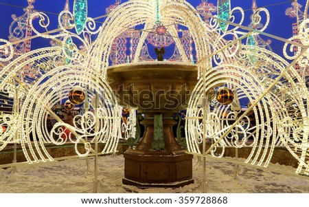 Electric fountain at night, lighted during christmas near the Bolshoi Theatre (Large, Great or Grand Theatre, also spelled Bolshoy), Moscow, Russia - stock photo