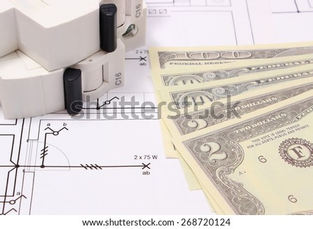 Electric fuse and money on electrical construction drawing of house, accessories for engineering work, concept for energy saving - stock photo