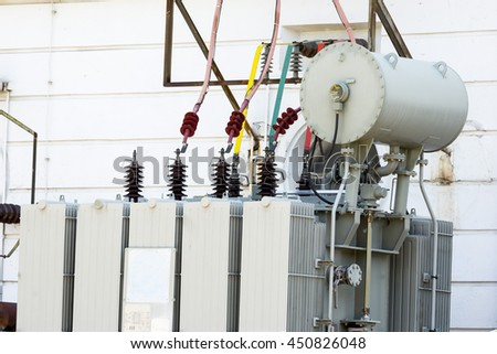 Electric generator in a small hydro power facility. Outside of the water plant. - stock photo