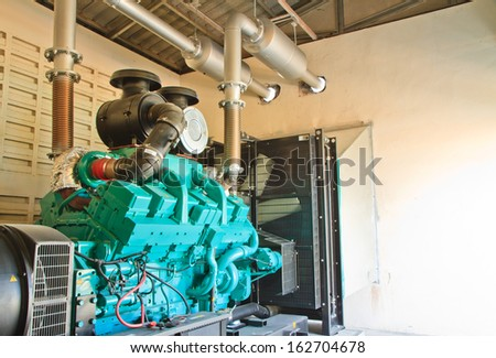 electric generator of machine in room at industry