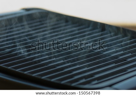 Electric grill smoldering