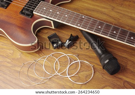 Electric guitar and microphone - stock photo