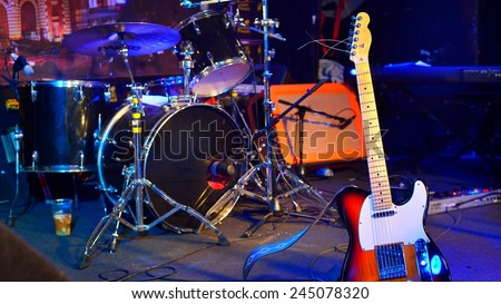 Electric guitar and other musical equipment on stage before conc - stock photo