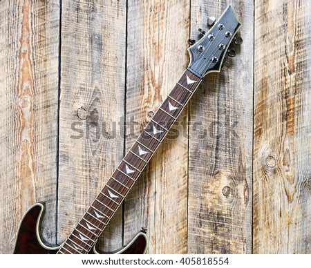 Electric guitar body on wooden background vintage look - stock photo