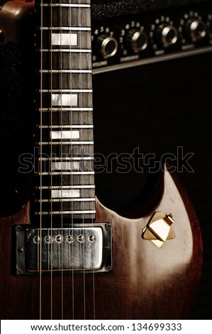Electric Guitar Close Up And Amplifier