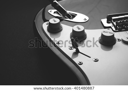 Electric guitar. Detail, selective focus . Shallow depth of field. Music, learning how to play the guitar and abstract concept