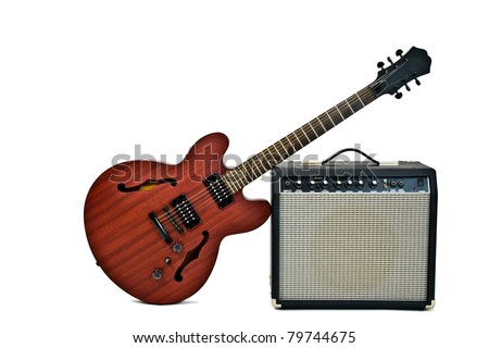 electric guitar leaning on a small amplifier - stock photo