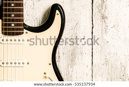 Electric guitar on an white wooden board, on top, horizontal
