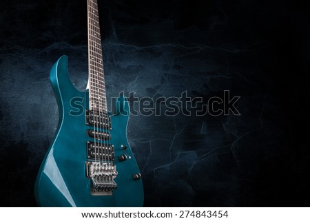 electric guitar on black background - stock photo