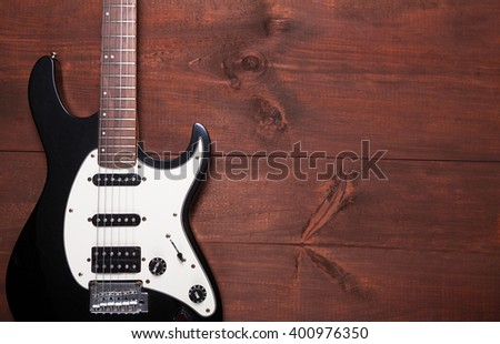 Electric guitar on the wooden table