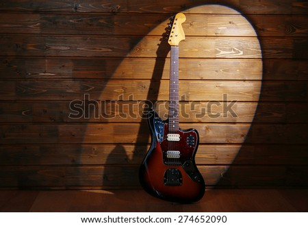 Electric guitar on wooden background - stock photo