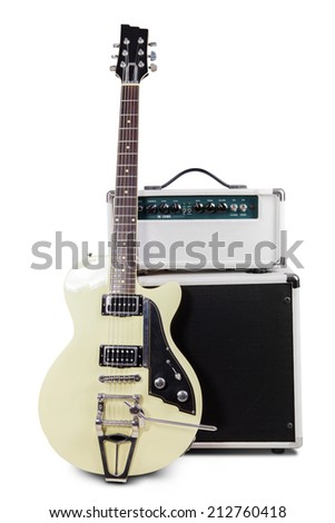 Electric guitar with amplifier, isolated on white background - stock photo