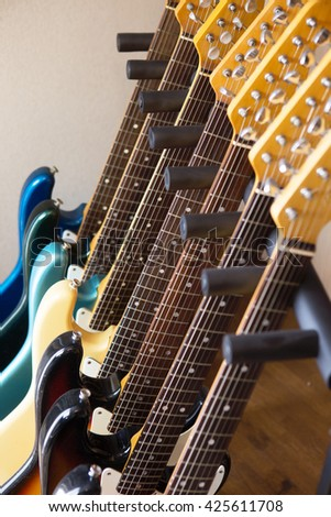 Electric guitars in the studio on a guitar stand. - stock photo