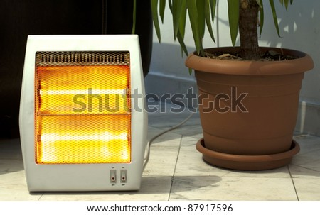 Electric heater and Pot close up - stock photo