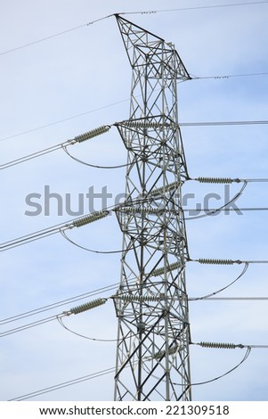 electric high voltage power post - stock photo