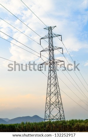 Electric high voltage power post on sugarcane farm