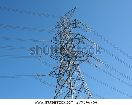 electric high voltage power post with blue sky. - stock photo