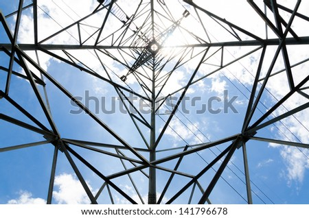 Electric High Voltage Transmission Tower with blue sky - stock photo