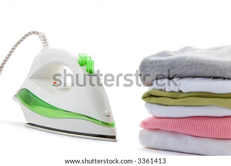 electric iron and clothes on a white background - stock photo
