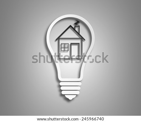 Electric light bulb and house inside it as symbol of green energy. concept ecology. the image of the light bulb on a light background - stock photo