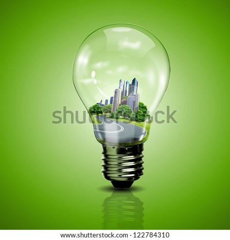 Electric light bulb and our planet inside it as symbol of green energy - stock photo