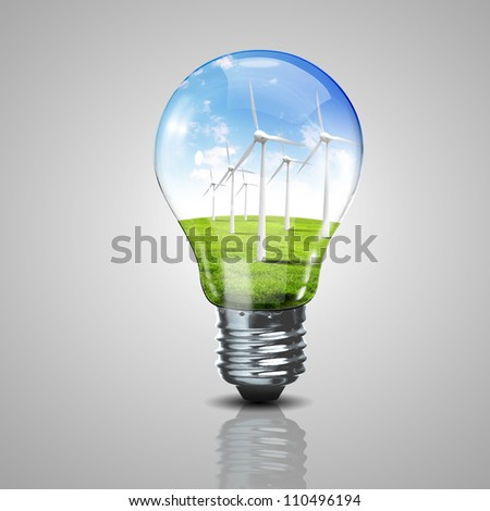 Electric light bulb and wind meels inside it as symbol of green energy - stock photo