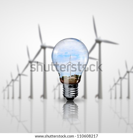 Electric light bulb and wind meels inside it as symbol of green energy