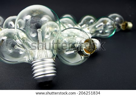 Electric light bulbs incandescent isolated on black background - stock photo
