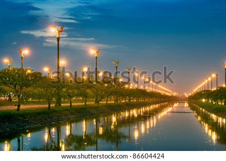electric light in perspective canal - stock photo