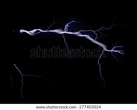 Electric lightning discharge on a black background - stock photo