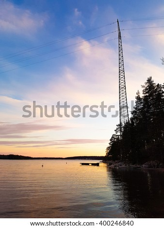 Electric line above water, at a evening, in Raasepori, Uusimaa, Finland