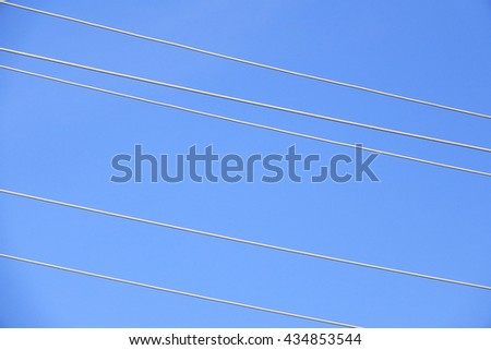 electric line on sky background:select focus with shallow depth of field.  - stock photo