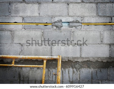 Electric line pipe in wall,construction site