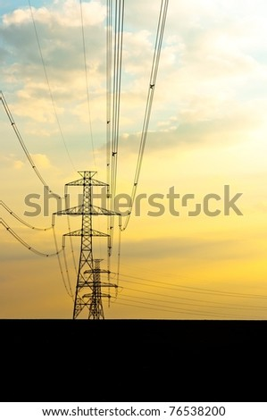 Electric lines with sunset - stock photo