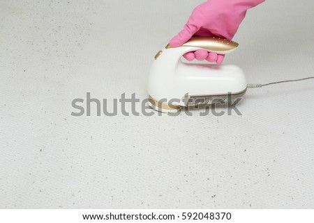 Electric Lint And Fuzz Remover Working On The Mattress Surface. Fabric  Shaver. Upholstered Furniture