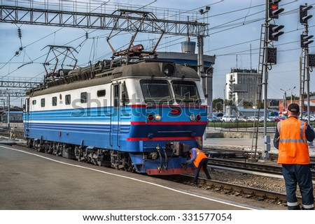 Electric locomotive after unhitching from the train, at railway station - stock photo