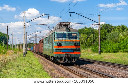 Electric locomotive hauling a cargo train - stock photo