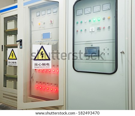 Electric measuring devices and switches are located on panels  - stock photo