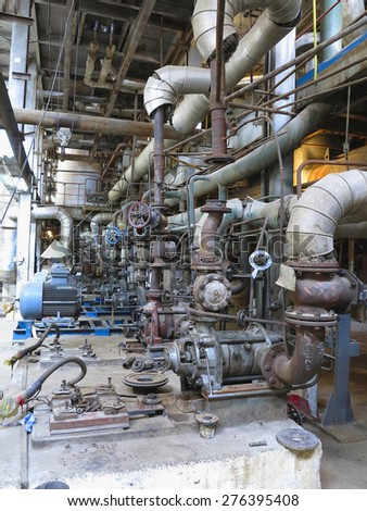 Electric motors driving industrial water pumps during repair at power plant - stock photo