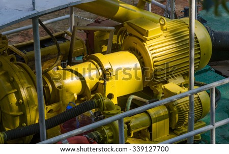 Electric motors driving water pump on small special ship. - stock photo