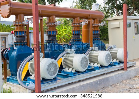 Electric motors driving water pumps of waste water treatment system. - stock photo