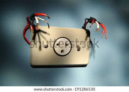 Electric outlet monster - stock photo