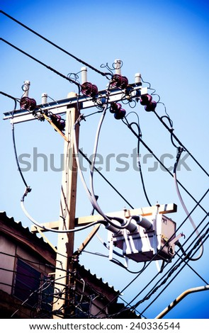 Electric pillar with transformer in the electric network. Outdoor view  / Electrical powered pillar In Bangkok, Thailand / Electric pillar in the electric network (electric, pillar, power)  - stock photo