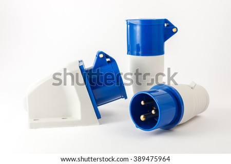 Electric plastic power plug and various sockets with cap isolated on white background - stock photo