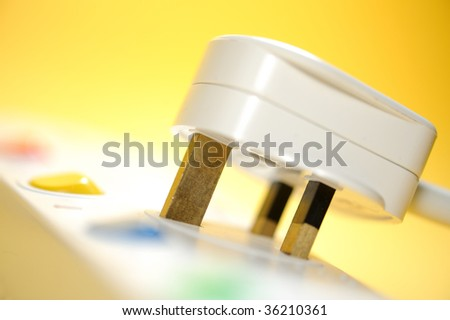 electric plug on a yellow background