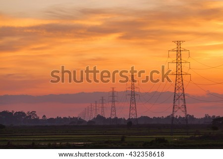 Electric pole at sunset twilight landscape